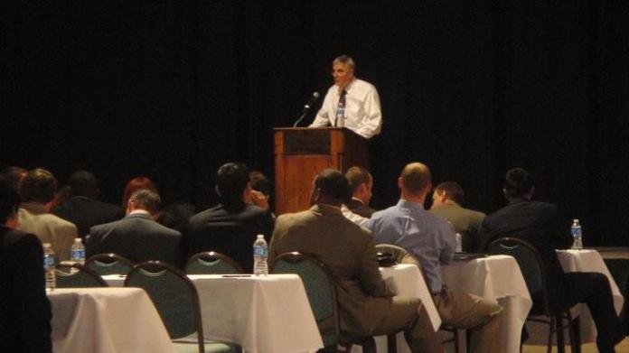 Photo of Larry Tenambaum giving a speech.